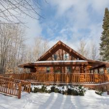 Cedar Log Railing Surrounds Porch