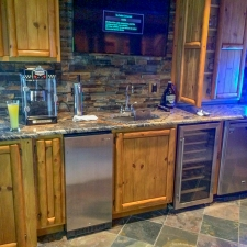 Log & Panel Custom Stained Bar Cabinets