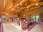 Living Room with White Pine Paneling Ceiling & Timber Trusses