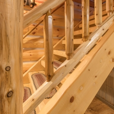 Timber Knotty Pine Stairway shown with Log Railing