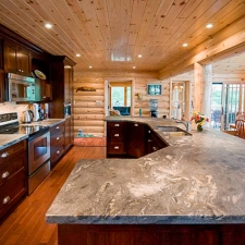 Kitchen with Log Siding accent wall