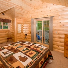 Master Bedroom with Log Siding