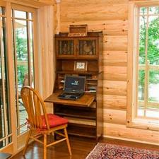 Corner Desk with Log Siding wall