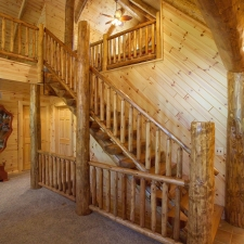 Interior Half Log Stairway with Log Railing