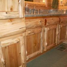 Rustic Cedar Log Panel Kitchen Cabinets