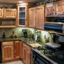 Rustic Cedar Log and Panel Kitchen Cabinetry