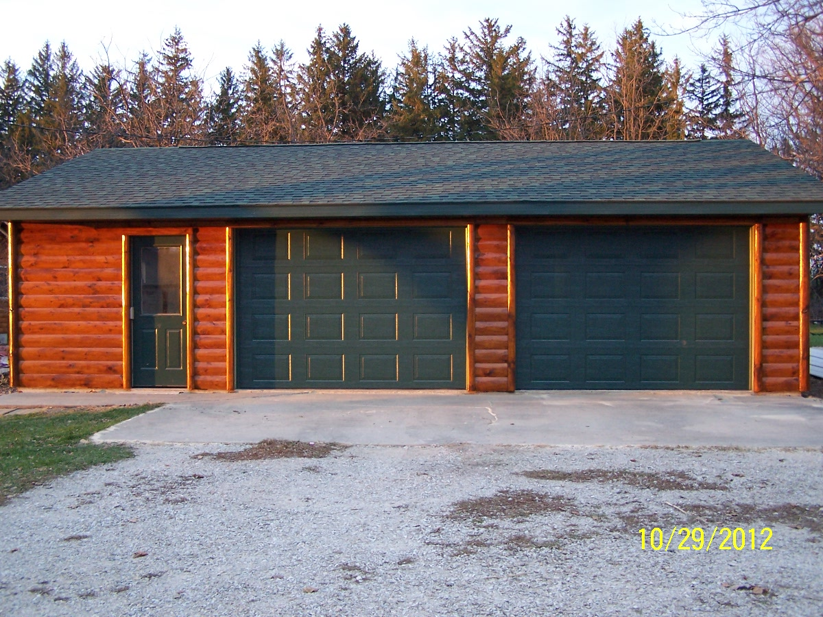 Renovating a detached garage with log cabin wood siding for Log cabin garage