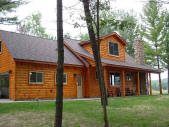 Golf Course Home with Log Siding
