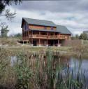 Cedar Valley Golf Course Log Sided Home