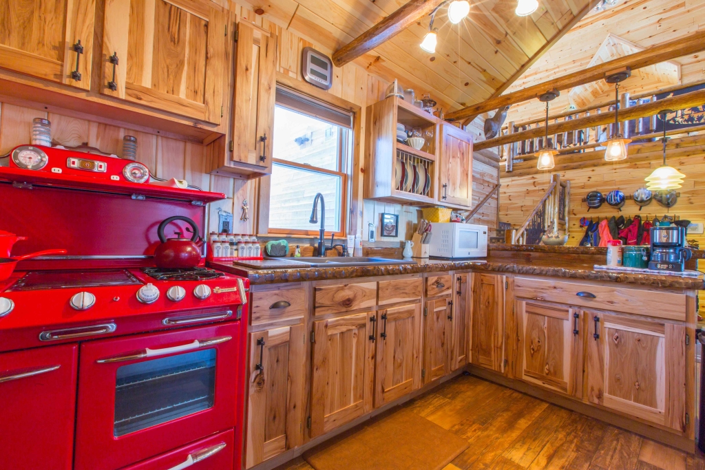 Using Rustic Wood Panels & Log Cabinets In Your Kitchen