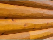 Prefinished log siding for a rustic finish
